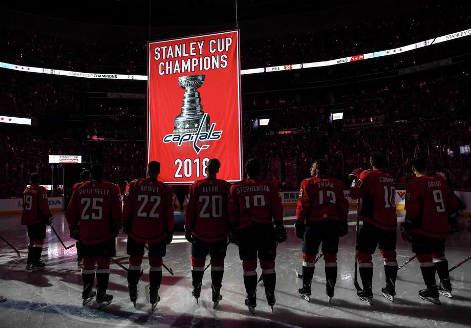 6edc9eeb0 The Washington Capitals watch the franchise s first championship banner get  raised to the rafters at sold