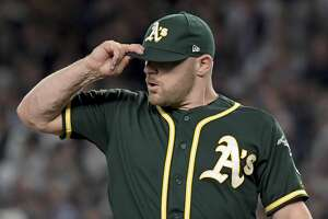 Oakland Athletics pitcher Liam Hendriks reacts after giving up a two-run home run to New York Yankees' Aaron Judge during the first inning of the American League wildcard playoff baseball game, Wednesday, Oct. 3, 2018, in new York (AP Photo/Bill Kostroun)