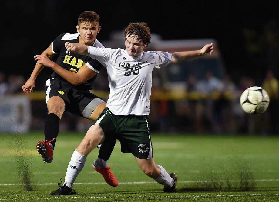 Hand's Lee Wildermann battles Guilford's Jack Clancy during Wednesday's SCC match at Strong Stadium at the Surf Club in Madison. Hand won, 2-1. Photo: Catherine Avalone / Hearst Connecticut Media / New Haven Register