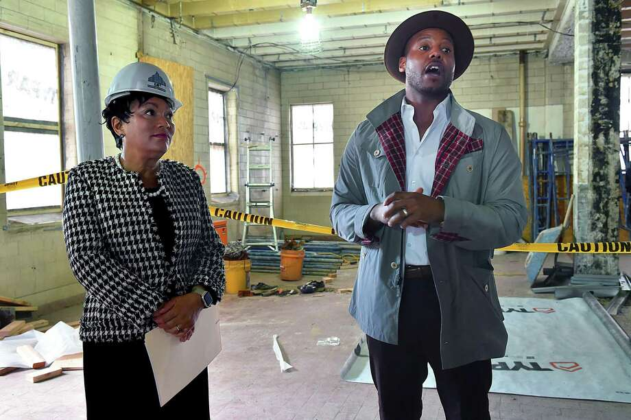 Titus Kaphar, artist and co-founder of NXTHVN, a sustainable creative art space at 169 Henry St. in New Haven, gives a tour of the former manufacturing plant to Mayor Toni N. Harp and others Wednesday. Photo: Catherine Avalone / Hearst Connecticut Media / New Haven Register