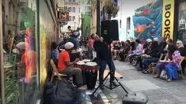 Musicians perform outside Vesuvio's for the anniversary celebration.