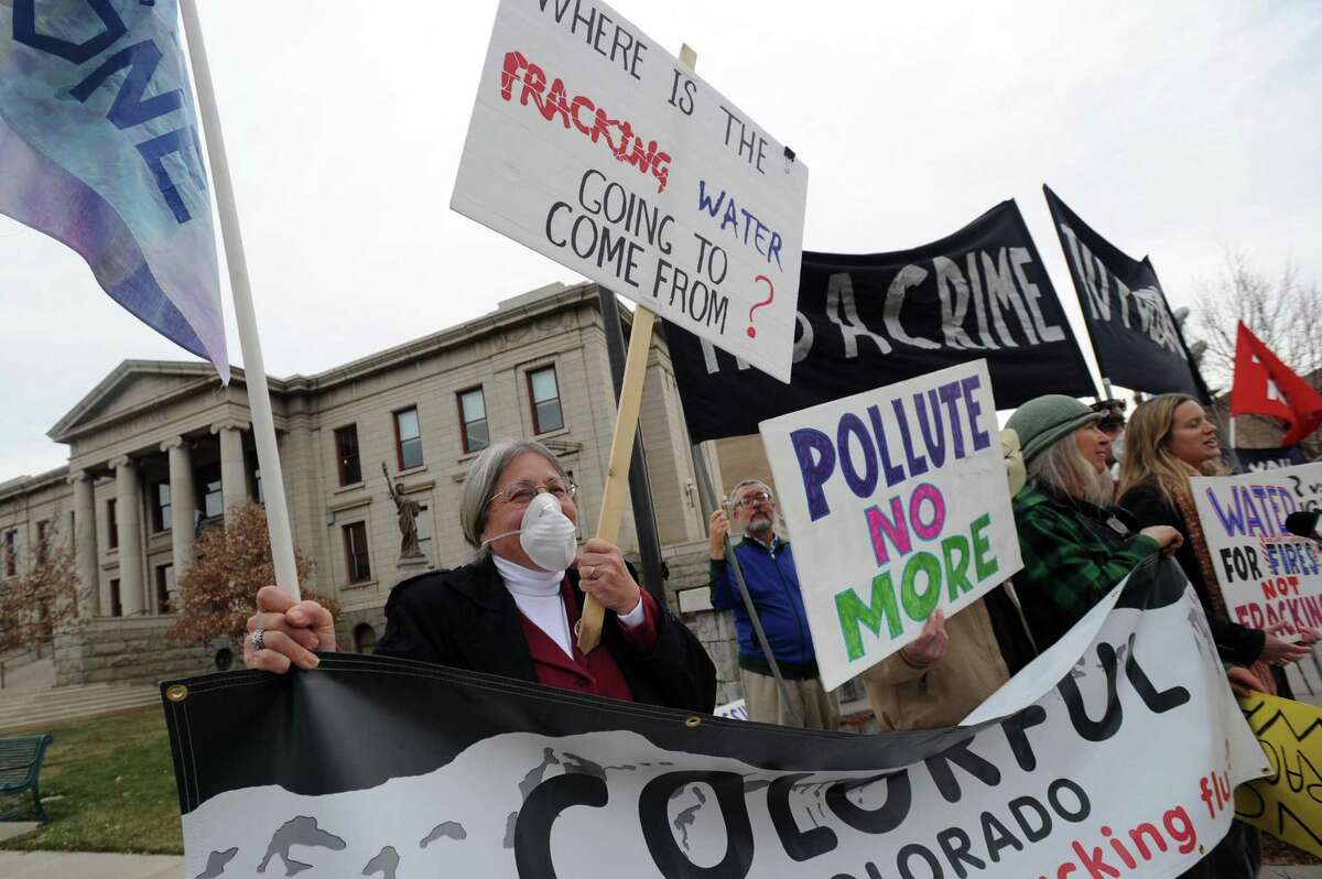 Fracking has been controversial issue in Colorado for years. In this photo from 2012, retired school teacher Elaine Doudna joins about 20 other protesters outside City Hall in downtown Colorado Springs, Colo.