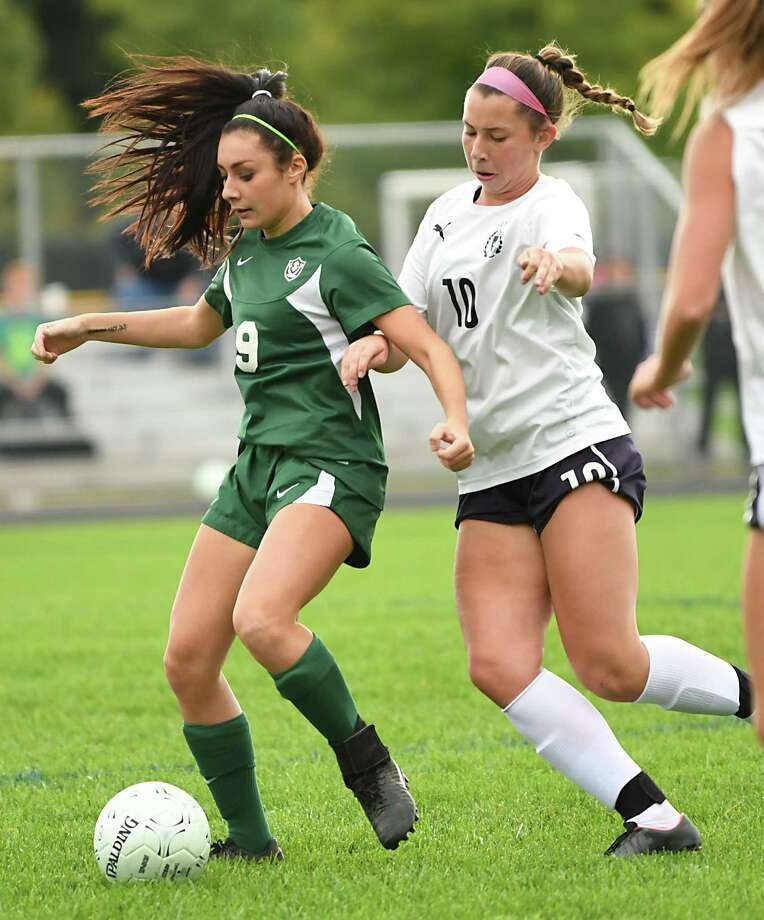 Schalmont's Sofia Cassano #9, battles for the ball with Academy of Holy Names' Megan Marini, #10, during a soccer game on Wednesday, Oct. 3, 2018 in Rotterdam, N.Y. (Lori Van Buren/Times Union) Photo: Lori Van Buren / 20044979A