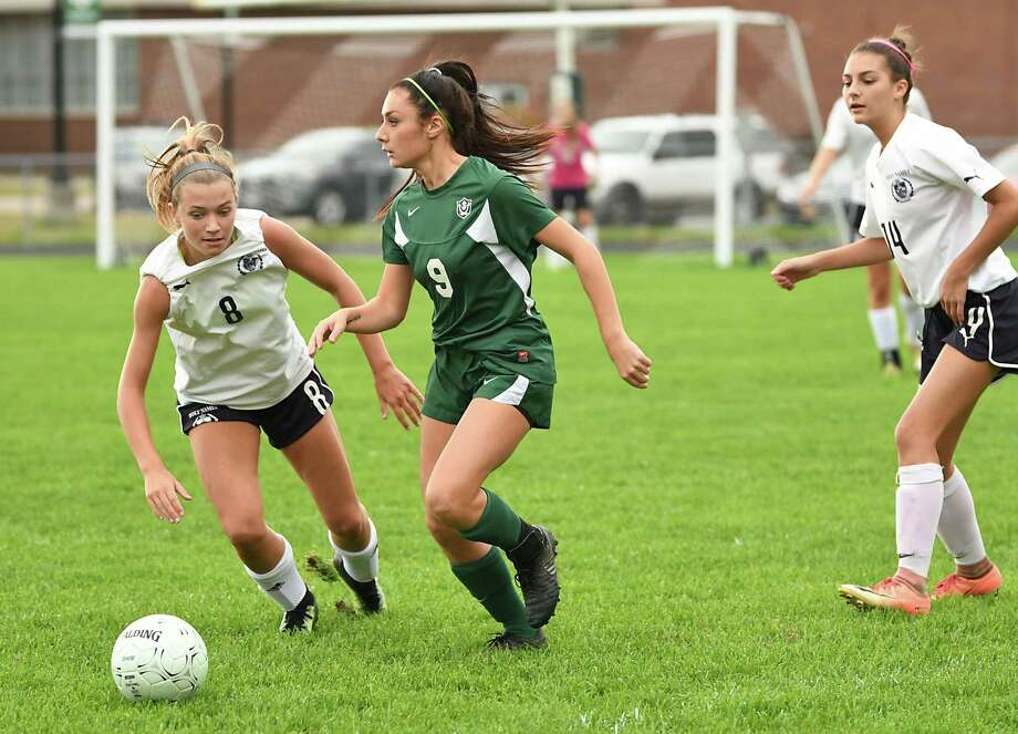 Schalmont's Sofia Cassano #9, looks for a teammate to pass the ball to with Academy of Holy Names' Elizabeth Harris, left, not far behind during a soccer game on Wednesday, Oct. 3, 2018 in Rotterdam, N.Y. (Lori Van Buren/Times Union) Photo: Lori Van Buren / 20044979A