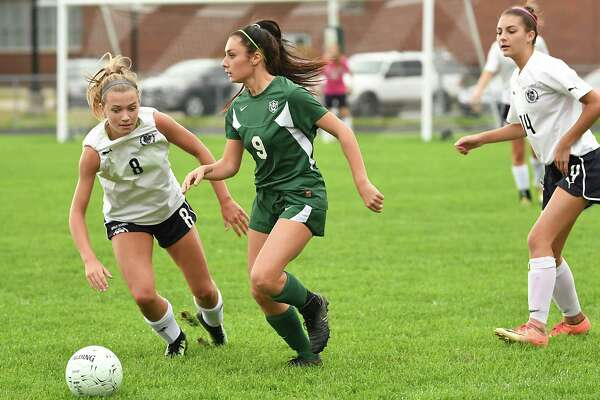 Schalmont's Sofia Cassano #9, looks for a teammate to pass the ball to with Academy of Holy Names' Elizabeth Harris, left, not far behind during a soccer game on Wednesday, Oct. 3, 2018 in Rotterdam, N.Y. (Lori Van Buren/Times Union)