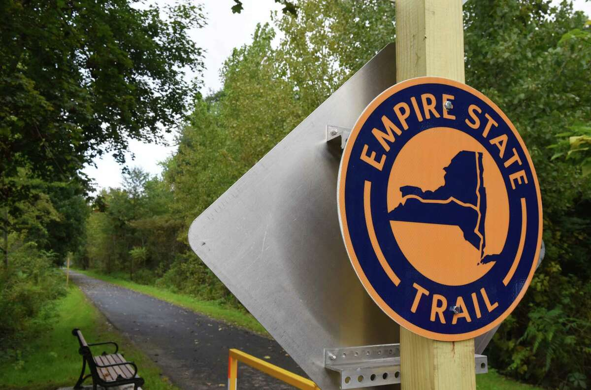 A sign marks a new 5-mile section of the Erie Canalway Trail at the Pattersonville Trailhead near the intersection of Route 5S and Scotch Church Rd. which is part of the 750-mile Empire State Trail on Wednesday, Oct. 3, 2018, in Pattersonville, N.Y. (Will Waldron/Times Union)