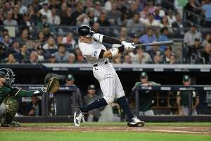The New York Yankees' Aaron Judge hits a two-run homer in the first inning of the American League wild-card game against the Oakland A's, at Yankee Stadium in the Bronx, Oct. 3, 2018. (Chang W. Lee/The New York Times)