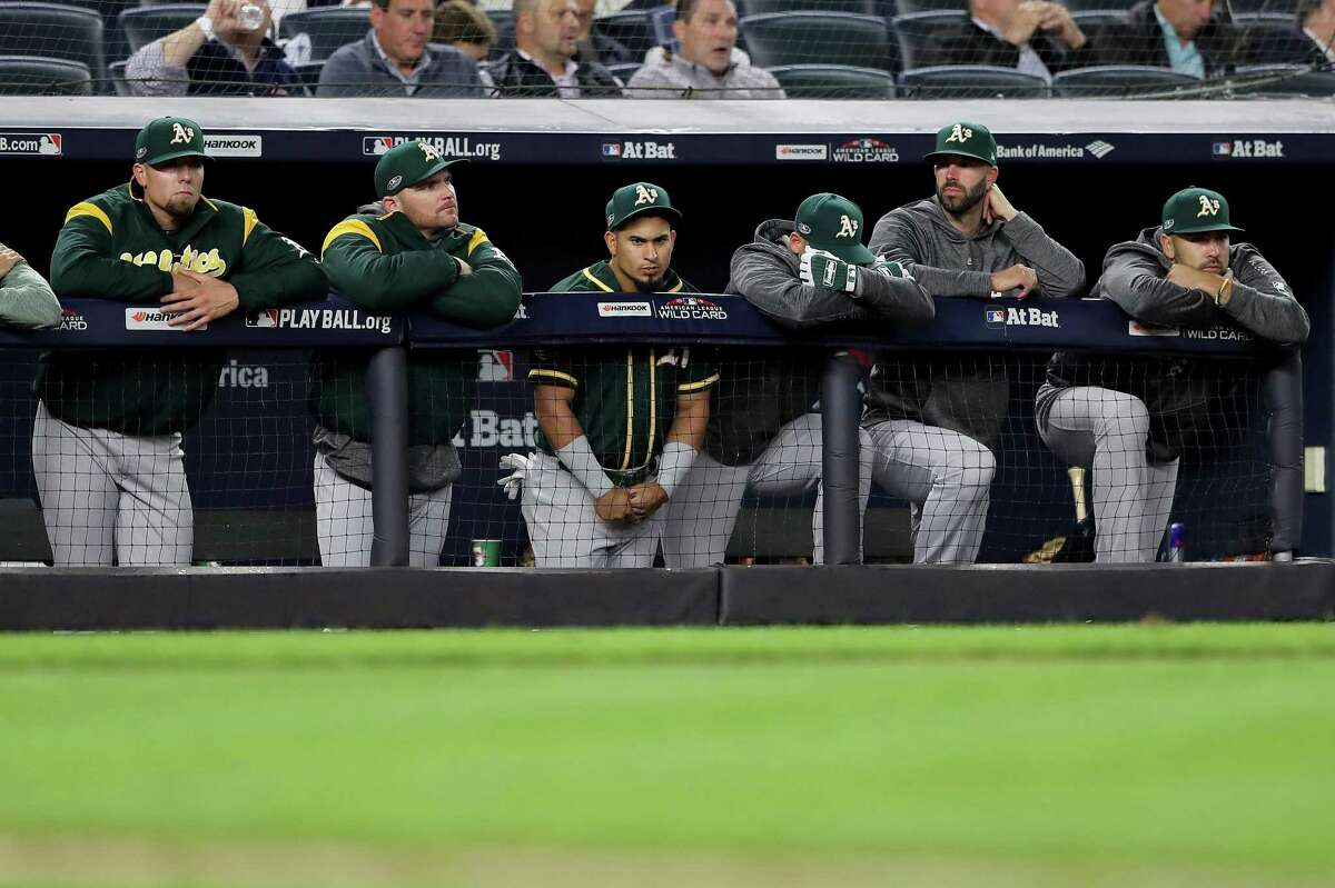 The Oakland Athletics bench reacts during the ninth inning against the New York Yankees in the American League Wild Card Game at Yankee Stadium on October 03, 2018 in the Bronx borough of New York City.