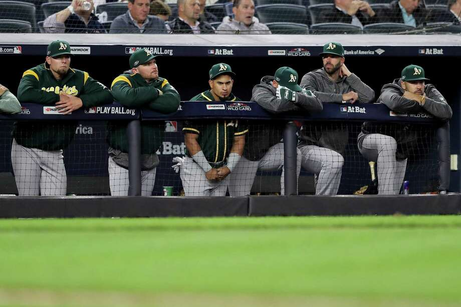 The Oakland Athletics bench reacts during the ninth inning against the New York Yankees in the American League Wild Card Game at Yankee Stadium on October 03, 2018 in the Bronx borough of New York City. Photo: Elsa / Getty Images / 2018 Getty Images