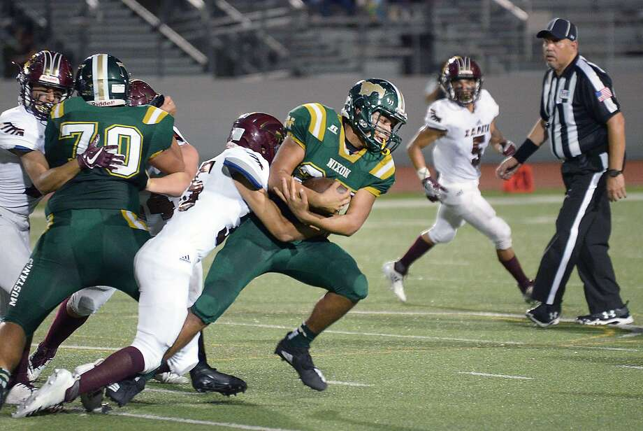 Mustangs runningback Pablo Tovar carries the ball as Robert Garcia defends for the Zapata Hawks Friday, September 21, 2018 at Shirley Field. Photo: Cuate Santos /Laredo Morning Times / Laredo Morning Times