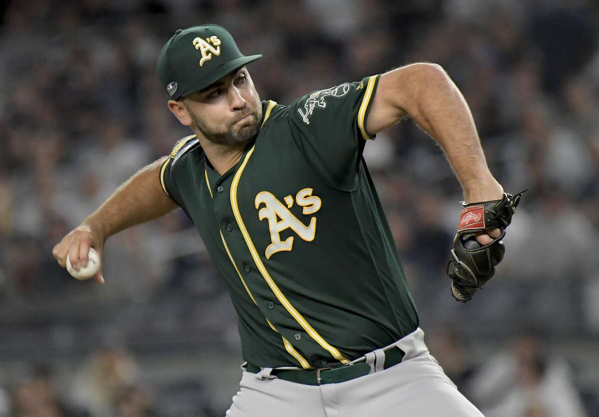 Oakland Athletics' pitcher Lou Trivino delivers against the New York Yankees during the third inning of the American League wild-card playoff baseball game, Wednesday, Oct. 3, 2018, in New York. (AP Photo/Bill Kostroun)