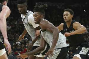 San Antonio Spurs' Lonnie Walker IV moves the ball during the Silver & Black Open Scrimmage at the AT&T Center, Wednesday, Oct. 3, 2018.
