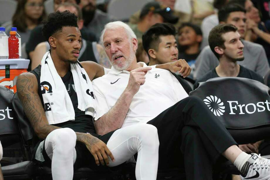 San Antonio Spurs' head coach Gregg Popovich talks with Dejounte Murray during the Silver & Black Open Scrimmage at the AT&T Center, Wednesday, Oct. 3, 2018. Photo: JERRY LARA / San Antonio Express-News / © 2018 San Antonio Express-News