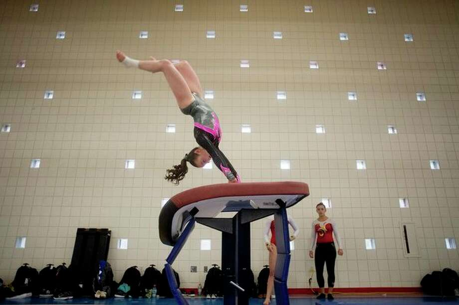 Midland's Rylie Johnstone practices her vault routine during the USA Gymnastics Level 10 state championship meet at Northwood University in 2016. (Daily News file photo) / Midland Daily News