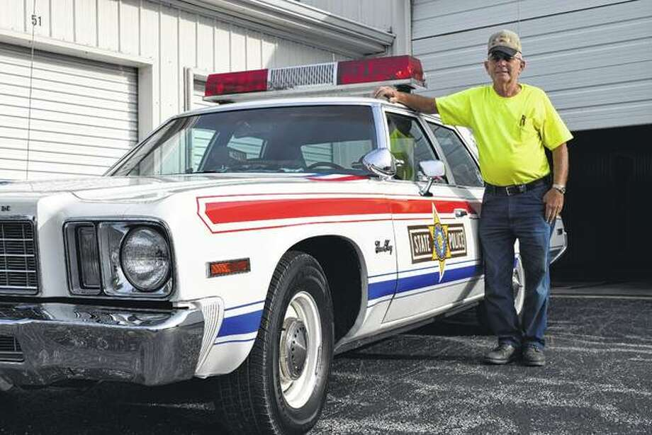 Retired Illinois State Police Trooper Henry Rosenberger of Waverly shows his restored 1976 Plymouth Gran Fury, which is marked with Illinois State Police and America's bicentennial graphics. Photo: Greg Olson | Journal-Courier