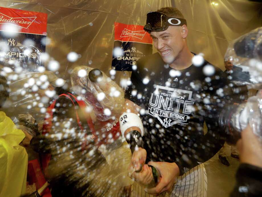 New York Yankees' Aaron Judge celebrates in the locker room after the Yankees beat the Oakland Athletics 7-2 in the American League wild-card playoff baseball game, Wednesday, Oct. 3, 2018, in New York. (AP Photo/Frank Franklin II) Photo: Frank Franklin II / Associated Press / Copyright 2018 The Associated Press. All rights reserved.