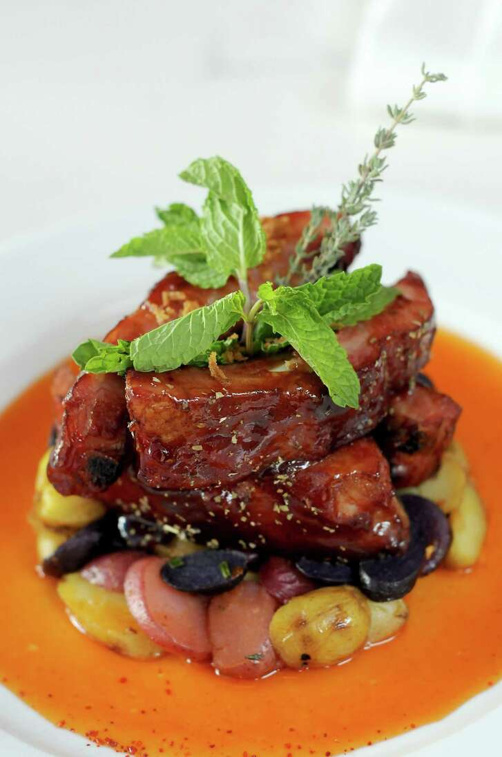 The Roasted Pork Ribs, candied goose fat, sweet peppers sauce and Grenaille sautéed potatoes at the new La Villa Saint-Tropez restaurant on Montrose Wednesday Oct.03, 2018.