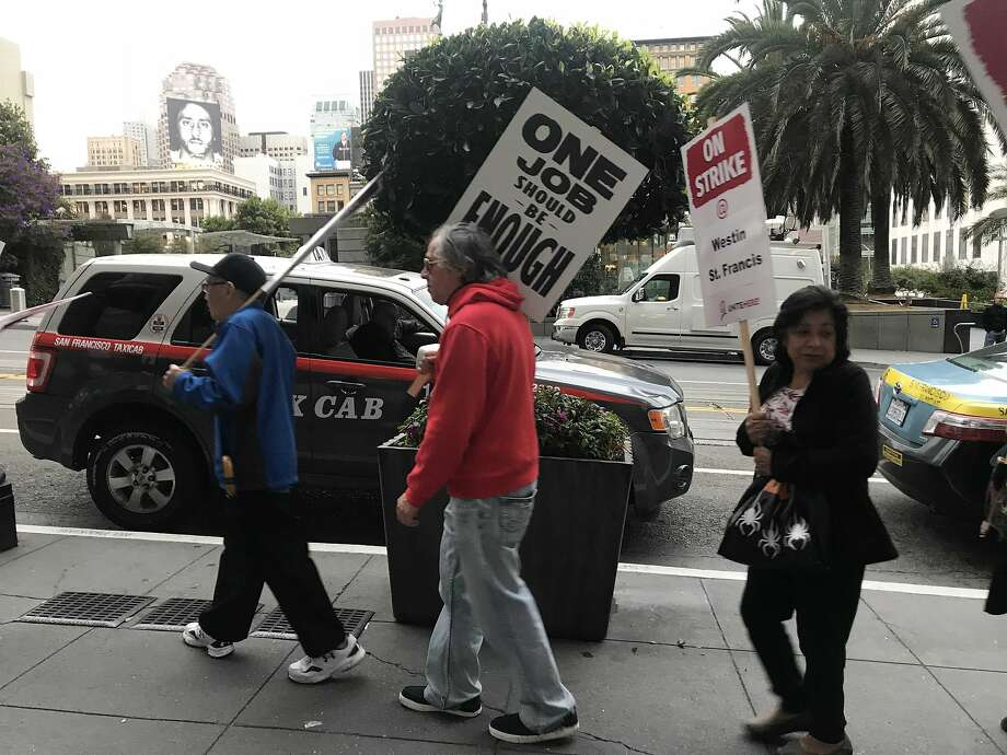 On Thursday, nearly 2,500 hotel workers employed by Marriott walked off their jobs in San Francisco call for higher wages and greater job security. Photo: Sarah Ravani / The Chronicle