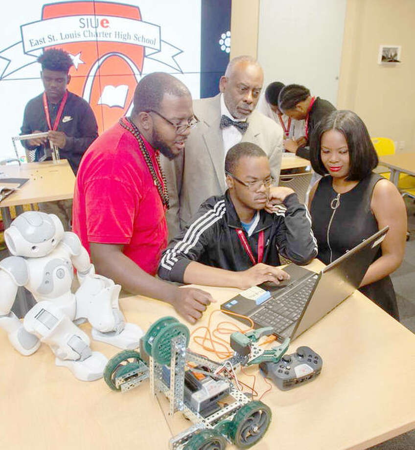 Darweshi Amerson, CHS sophomore and co-captain of the robotic team, (center) works in the SIUE East St. Louis Charter High School STEM lab. Watching are, from left, CHS STEM faculty member Johnathan Tate, CHS Assistant Director Willis Young and CHS Director Gina Jeffries. Photo: For The Telegraph