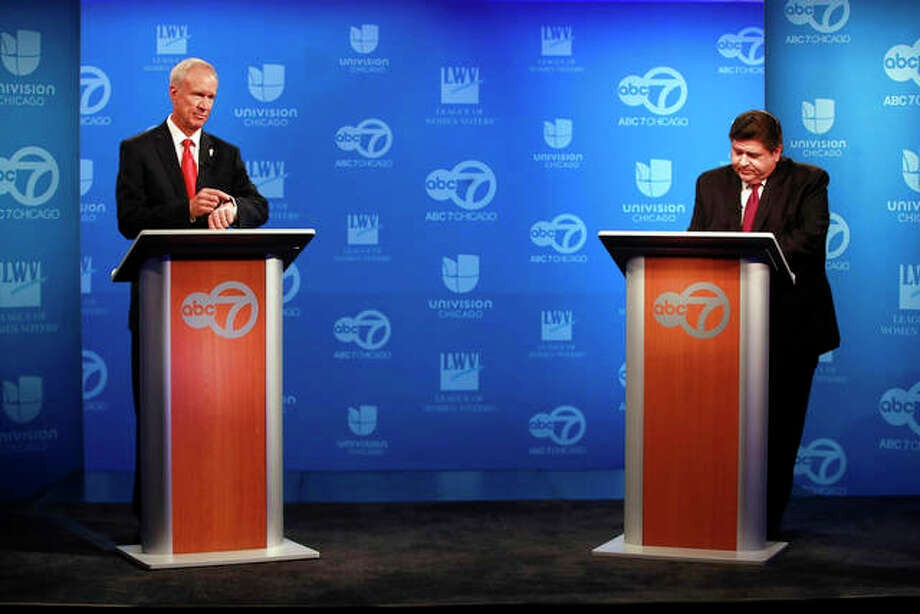 Gubernatorial candidates Gov. Bruce Rauner and Democratic challenger J.B. Pritzker prepare for a televised debate in Chicago. Nuccio DiNuzzo | Chicago Tribune (AP)