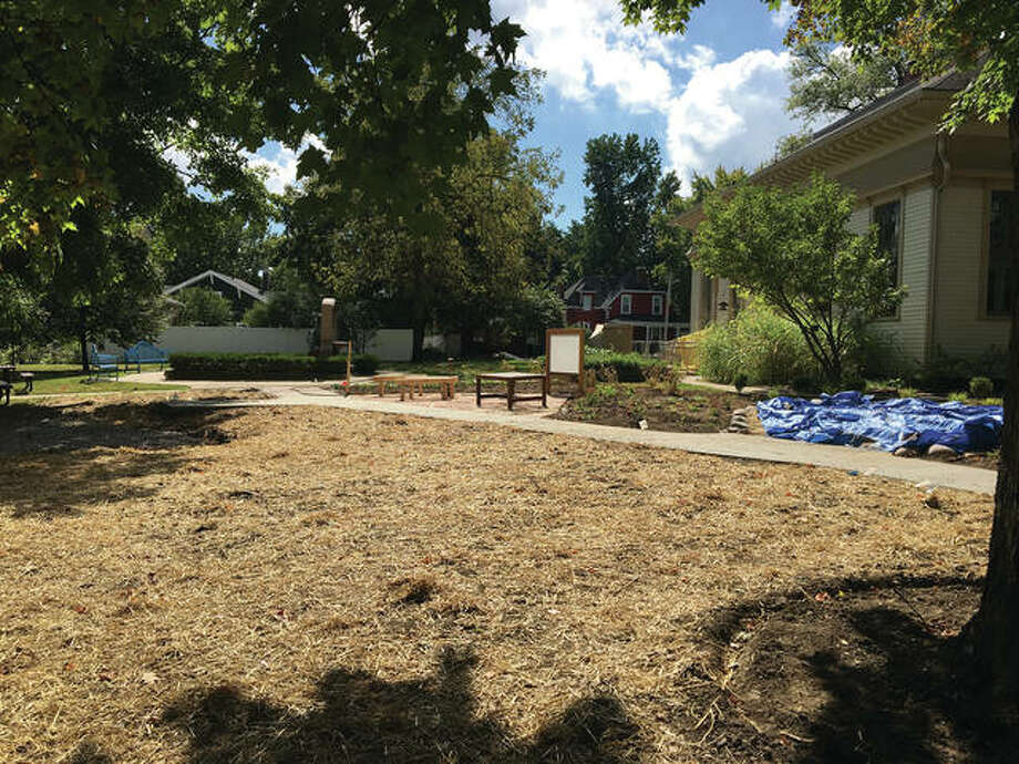The finishing touches are being applied to the grounds at the Edwardsville Children's Museum prior to its Oct. 8 reopening.