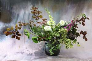 Nandina and foxglove add interest to an arrangement.