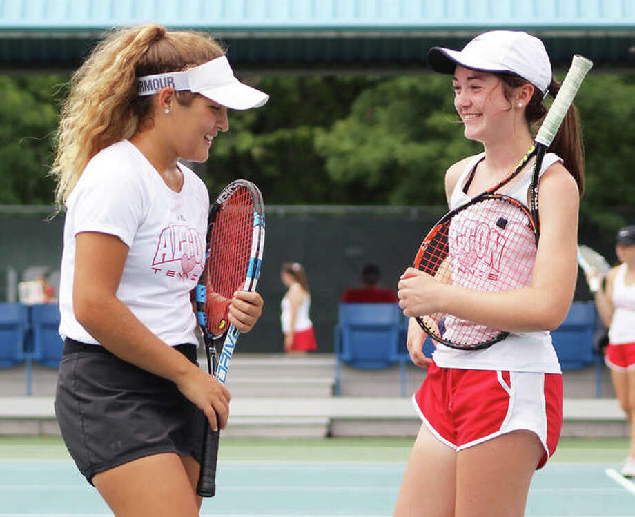 Alton's Hannah Macias (left) and Maddie Saenz share a laugh during their No. 1 doubles match at Alton's Robert Logan Invitational girls tennis tourney on Sept. 18 at LCCC's Andy Simpson Tennis Center in Godfrey. Macias, Saenz and their Redbirds teammates will be at Belleville East on Friday and Saturday for the Southwestern Conference Tournament. Edwardsville is a nine-time defending SWC champion, but enter the tourney after finishing second in the SWC's dual schedule behind Belleville East. The Tigers must finish ahead of East in the tournament to at least earn a share of the 2018 SWC championship. Photo: Greg Shashack / The Telegraph