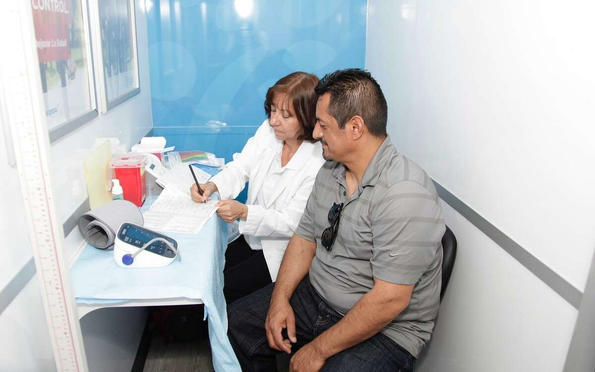 As part ofCignaSunday Streets,Cigna?'s Health Improvement Tour mobile van will provide Houston-area residents with free healthscreeningsfrom noon-4 p.m., Sunday, Oct. 7, at 3719 Irvington Blvd. The free event will close downIrvington Boulevard in between Bigelow and Cavalcade streets and allow residents to bike, walk, play and interact together as a community. Here, a patient interacts with a health care providerat an HIT event.