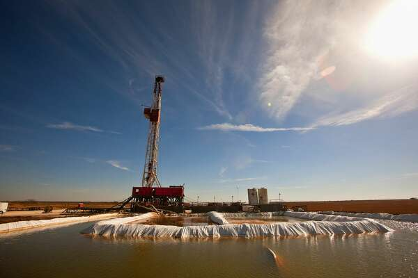 """FILE - This Feb. 17, 2016, file photo shows a water pool attached to Robinson Drilling rig No. 4 in Midland County, Texas. Ken Medlock, director of an energy-studies program at Rice University in Houston, says an assessment Tuesday, Nov. 15, 2016, by the U.S. Geological Survey that the Wolfcamp Shale in the Midland region could yield 20 billion barrels of oil is another sign that """"the revival of the Permian Basin is going to last a couple of decades."""""""