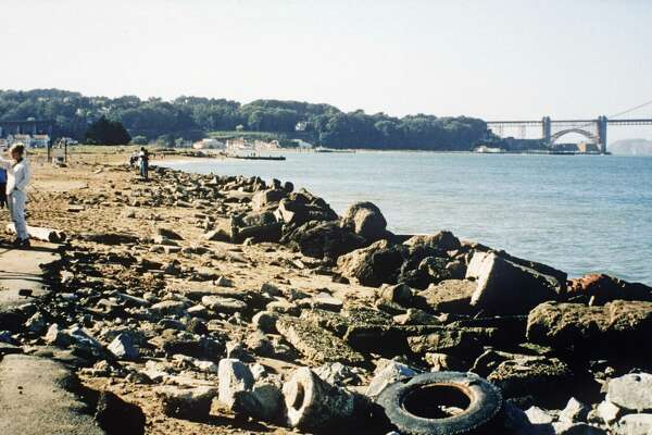 The beach at Crissy Field, littered with tires, before the cleanup.