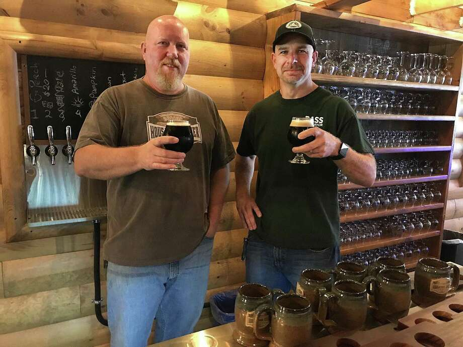 Owner Dave Littlefield and assistant brewer Tom Reardon hold glasses of Sacred Grounds Coffee Porter at Housatonic River Brewing in New Milford, Conn., on Thursday, Oct. 4, 2018. Photo: Chris Bosak / Hearst Connecticut Media / The News-Times