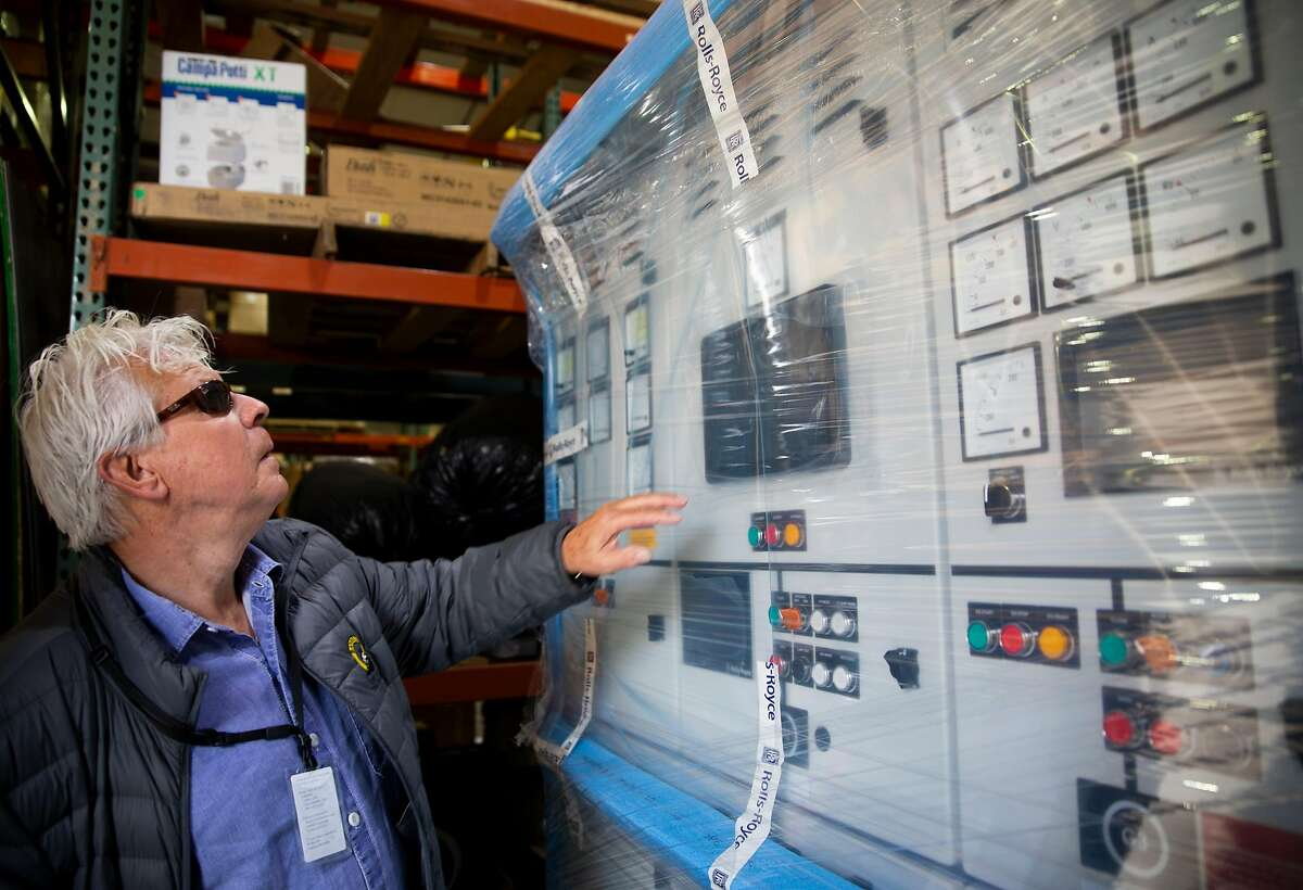 Peter Zwart, VP of Operations for Baydelta Maritime, takes a first look at the Rolls-Royce electronic switchboard system used to help operate the tugboat's Z-drive system at Nichols Brothers Boat Builders on Whidbey Island, Monday, Sept. 17, 2018 in Freeland, Washington. The multipurpose tractor tugboat will be the first with a hybrid propulsion system used on the West Coast, using a Rolls-Royce Z-drive that can operate as full diesel, full electric or as diesel-electric.