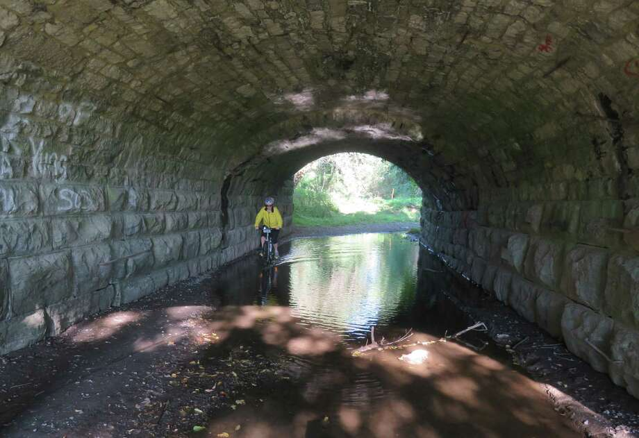 Outdoors writer Gillian Scott rides through a waterlogged tunnel in Glenville. Photo: Picasa, Herb Terns/Times Union