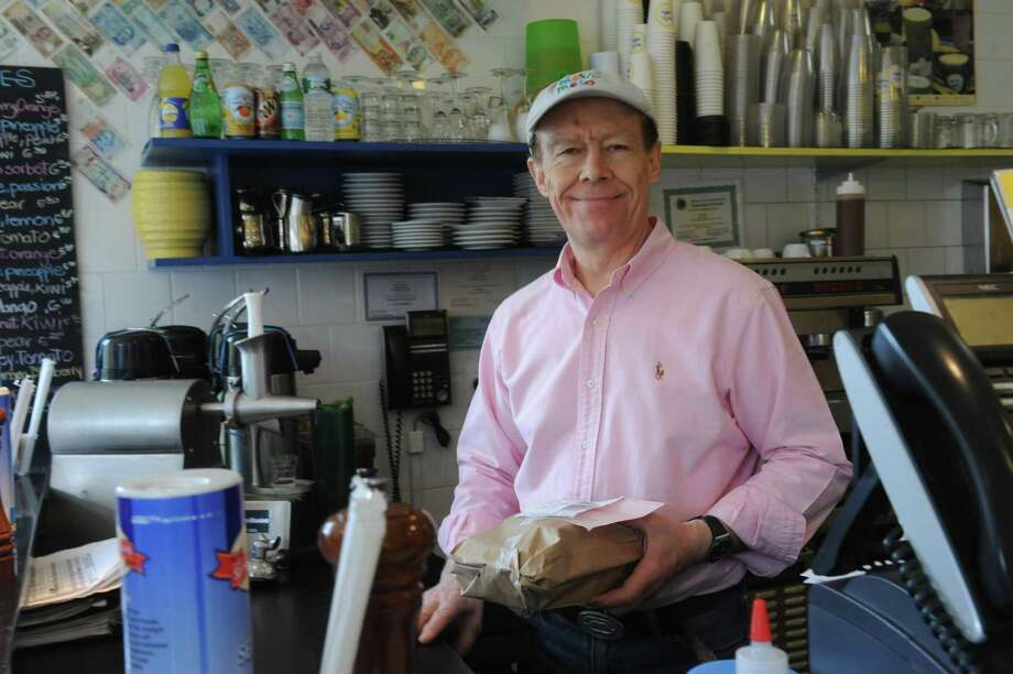 Marc Penvenne, the owner of Meli-Melo, sits at the juice bar at the restaurant, on Greenwich Avenue. Photo: File Photo / Greenwich Time