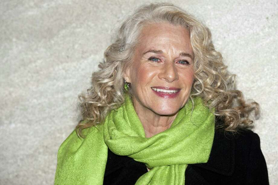 """Carole King attends the Rockefeller Center Christmas tree lighting, in New York. King has surprised the cast of the Broadway musical about her life, walking out on stage at the Stephen Sondheim Theater during the curtain call of """"Beautiful."""" She then sang one of her biggest hits, """"You've Got a Friend,"""" trading verses with Jessie Mueller, the actress that plays her in the show. King was reluctant until Thursday, April 3, 2014, to see the musical because it tells of a painful time in her life.(AP Photo/Charles Sykes, file) Photo: Charles Sykes / Associated Press / FR170266 AP"""