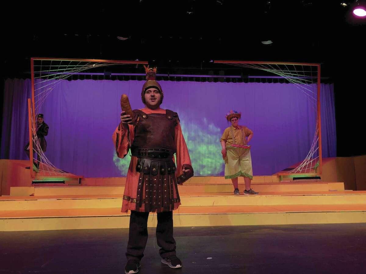 "Jacob Wheeler as Tartaglia, Trey Martin as Capitano Spevento, and Jonnathon Quinn as Brighella in Conroe High School's ""King Stag."""