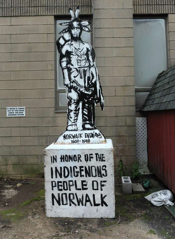 "A wooden, two-dimensional sculpture of an Native American that was place on city property stands at the Recreation and Parks garage after being removed Thursday, October 4, 2018, in Norwalk, Conn. Placed on a cement square in a plot of grass opposite the city's Christopher Columbus statue, was the ply-wood sculpture of a Native American, with the words ""In Honor of the Indigenous People of Norwalk"" inscribed. Photo: Erik Trautmann / Hearst Connecticut Media / Norwalk Hour"