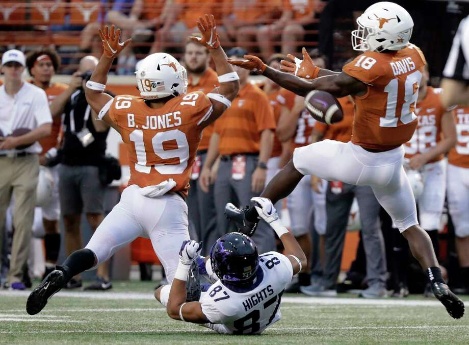 Texas defensive back Brandon Jones (19) an d defensive back Davante Davis (18) break up a pass intended for TCU wide receiver TreVontae Hights (87) during the second half of an NCAA college football game, Saturday, Sept. 22, 2018, in Austin, Texas. (AP Photo/Eric Gay) Photo: Eric Gay, Associated Press / Copyright 2018 The Associated Press. All rights reserved.