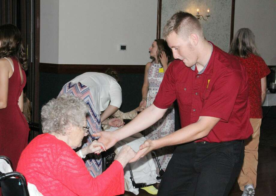 Ubly High junior Logan Hulbert and his dancing partner, Annabelle Bolzman, boogie their hearts out during Thursday's Huron County Senior Ball. The annual event brings students from all over the Thumb and senior citizens together for an afternoon of fun. Photo: Bradley Massman/Huron Daily Tribune