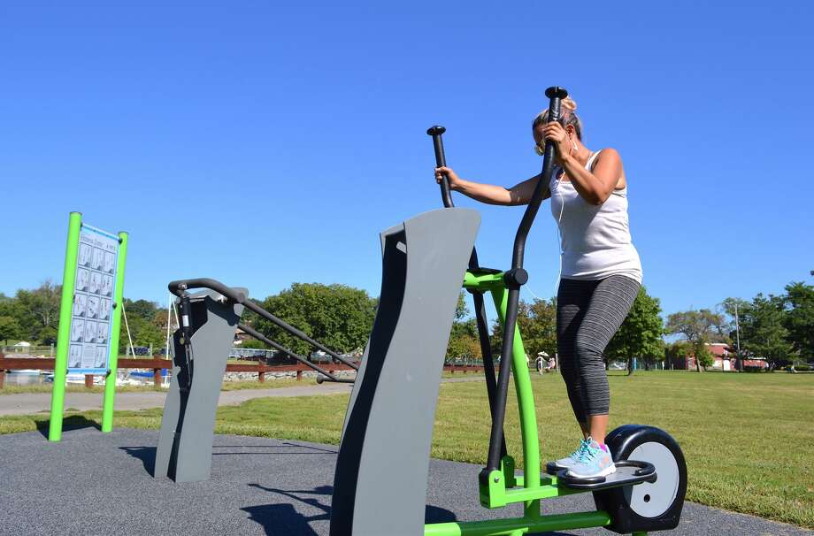 Xiomara Silva of Stamford uses the fitness equipment at Cove Island Park recently. Photo: Jarret Liotta / For Hearst Connecticut Media / Stamford Advocate freelance