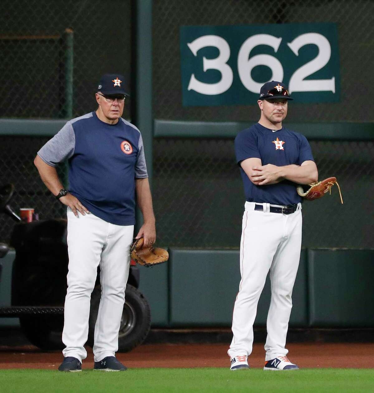 Houston Astros pitcher Joe Smith (38) talks with pitching coach Brent Strom during workouts at Minute Maid Park, October 4, 2018, in Houston.