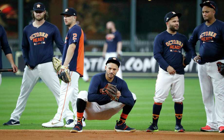 PHOTOS: A look at the Astros' workout before the ALDS Houston Astros shortstop Carlos Correa stretches during batting practice at Minute Maid Park, October 4, 2018, in Houston. Photo: Karen Warren, Staff Photographer / © 2018 Houston Chronicle