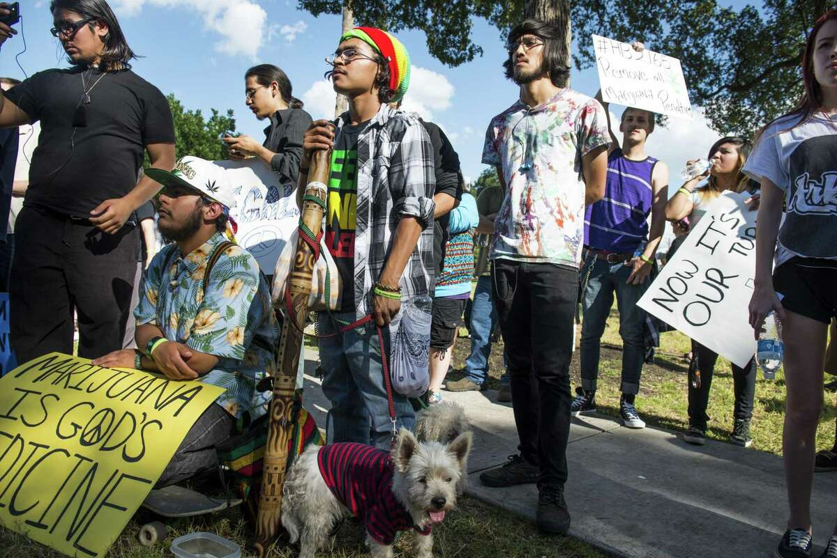 A crowd listens to presenters during a march held by San Antonio NORML, a chapter of the National Organization for the Reform of Marijuana Laws, their first rally and march, in support of reforming marijuana laws in Texas held downtown on Sunday, May 3, 2015.