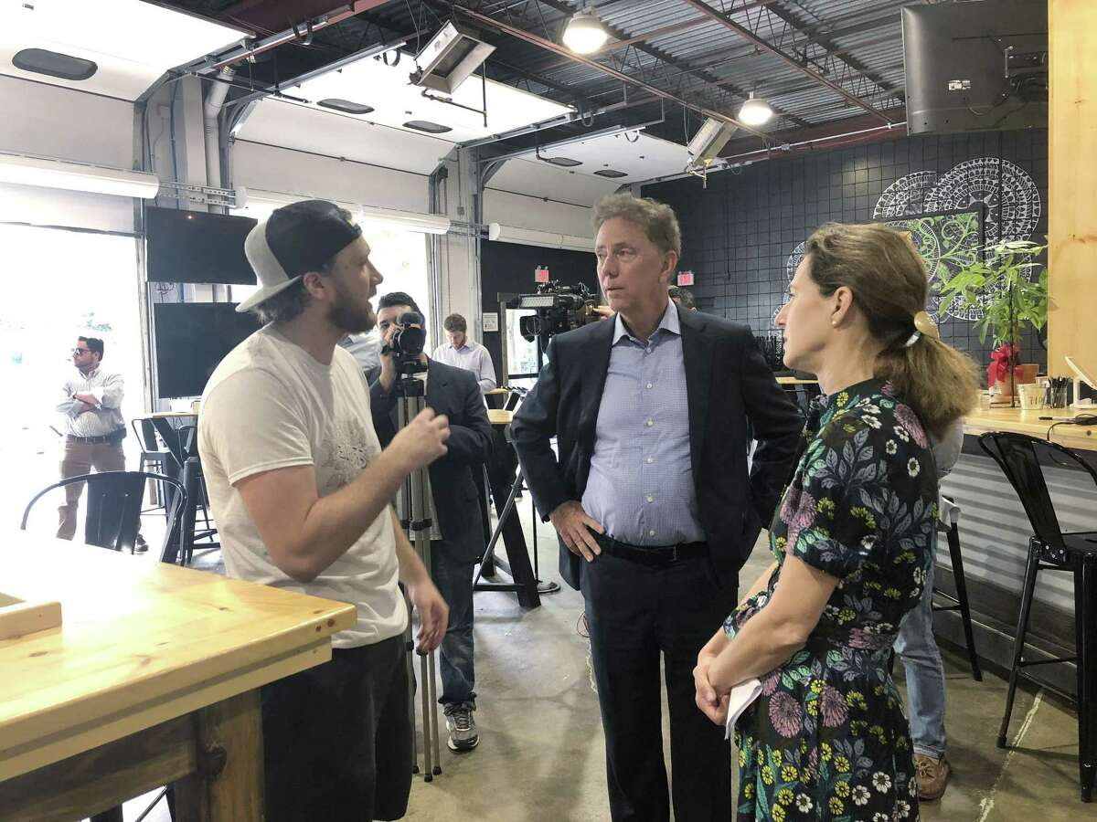 Ned Lamont, Democratic nominee for governor, and his running mate Susan Bysiewicz talk with Matt Weichner, a co-founder of Tribus Beer Co. in Milford Thursday Oct. 4, 2018.