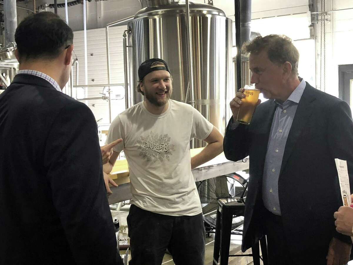 Ned Lamont, Democratic nominee for governor, and his running mate Susan Bysiewicz sample beer at Tribus Beer Co.