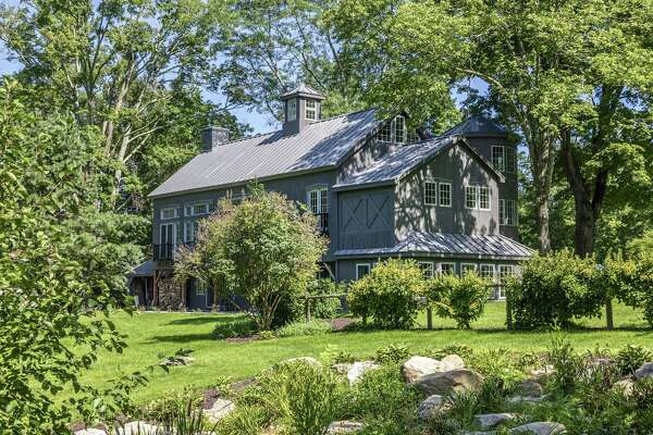 The home at 316 Kent Cornwall Road was originally built in 1797 as a barn for a 50-acre farm. It is the fourth home renovated by Pierre Kozely and Dawn Farmer, a couple who work as furniture designers and have also restored homes in New Mexico, New Hampshire and California.