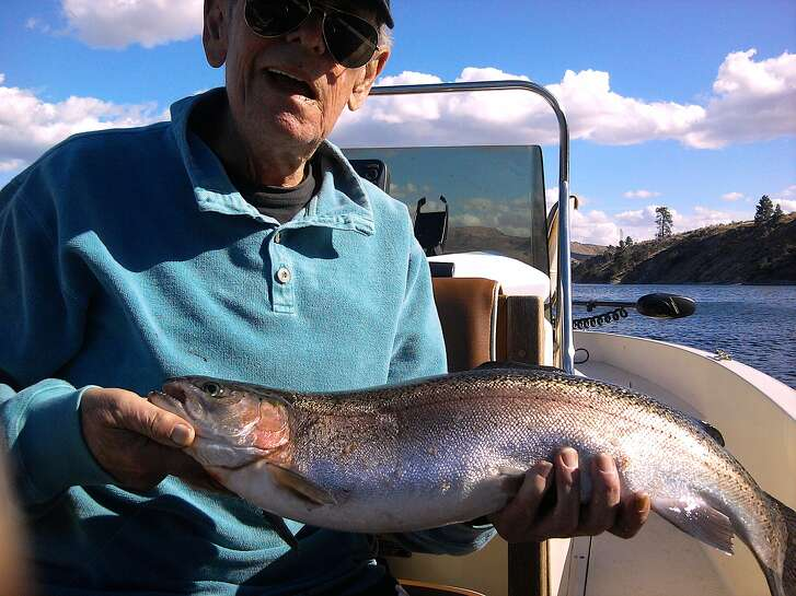 Flyfishing legend Ed Rice, nearly blind, caught and released this large rainbow trout while flyfishing at Rufus Woods Lake
