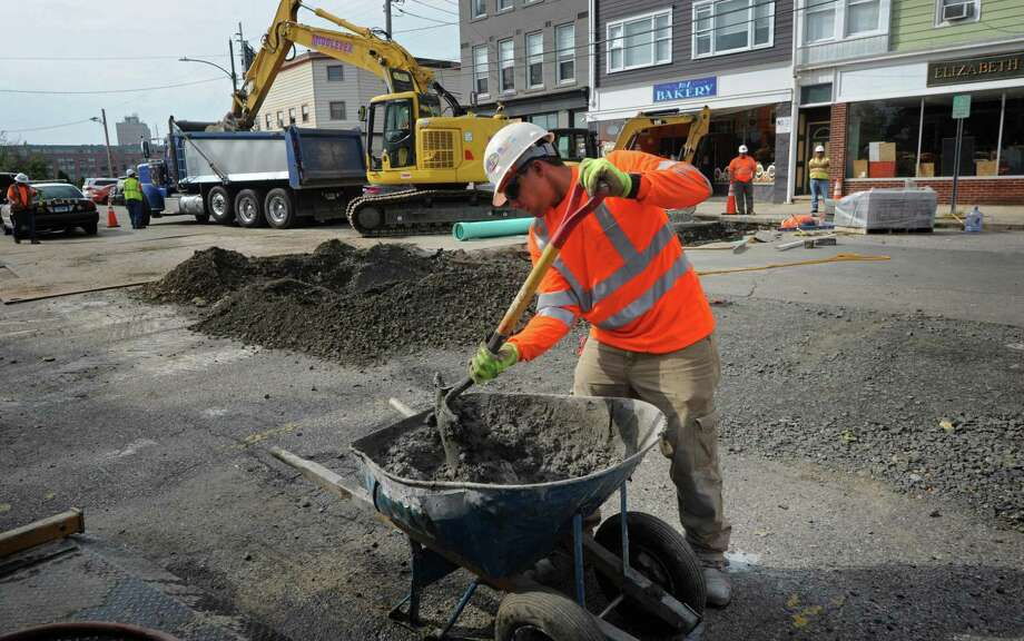 Middlesex Construction continues the drainage work in the parking lot of Liberty Square Thursday, October 4, 2018, in Norwalk, Conn. About 40 people attended the public information meeting hosted by the Parking Authority and led by Walker Consultants in the Community Room of City Hall to share their parking frustrations with the consultant charged with drafting the study and strategic plan Wednesday evening. Photo: Erik Trautmann / Hearst Connecticut Media / Norwalk Hour