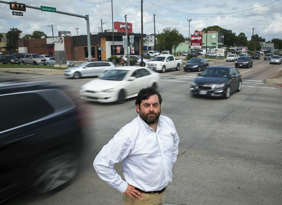 Jay Crossley stands at Shepherd and the Interstate 10 westbound frontage road in Houston, one of many spots where drivers jostle their way to freeway entrances and exits. Photo: Annie Mulligan/Contributor