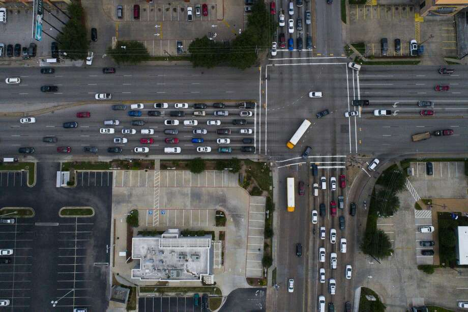 Westheimer Road spans ten lanes where it intersects with the eight lanes of Voss Road and Hillcroft Avenue. Photo: Mark Mulligan/Staff Photographer